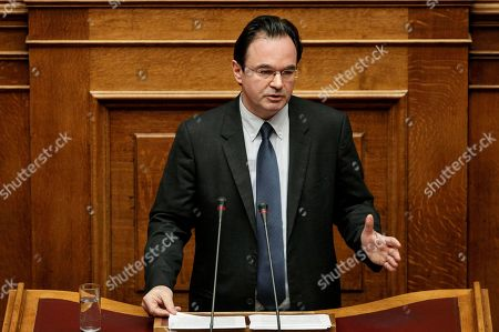 Former finance minister George Papaconstantinou addresses lawmakers during a Parliament session in Athens. A special court acquitted Papaconstantinou of felony charges of breach of faith and doctoring a document, in a case concerning Greeks with bank accounts in Geneva, and found him guilty of a lesser misdemeanor charge. Papaconstantinou, 53, received a one-year suspended prison sentence