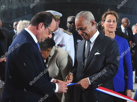 Stock Picture of French President François Hollande, left, the president of the Regional Council of the French overseas department of Guadeloupe Victorin Lurel, center, and Minister for Ecology, Sustainable Development and Energy Segolene Royal, inaugurate the Caribbean Center for the Expression and Memory of the Slave Trade and Slavery, known as the Memorial ACTe, in Pointe-a-Pitre, French Caribbean island of Guadeloupe, . French President Francois Hollande is to honor the memory of millions of slaves in an inaugural visit Sunday to a memorial in the French Caribbean island of Guadeloupe, where black men and women were sold to work on sugar cane plantations from the 17th to 19th centuries