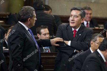 Roberto Villate, Roberto Alejos Democratic Freedom Revival Party Lawmaker Roberto Villate, right, listens to Roberto Alejos of Todos party during the election for a new Guatemalan Vice President to replace Roxana Baldetti, who resigned on Friday, May 8, at Congress in Guatemala City, . The discussion was suspended until Wednesday. The Former Vice President Baldetti resigned Friday, May 8, and gave up her immunity from possible prosecution after her former private secretary, Juan Carlos Monzon Rojas, was accused of being the ringleader of a scheme to defraud the state of millions of dollars by taking bribes in exchange for lower customs duties
