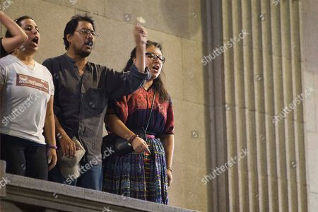 Protesters chant slogans against the election of a new Guatemalan Vice President to replace Roxana Baldetti, who resigned on Friday, May 8, inside Congress in Guatemala City, . The discussion was suspended for Wednesday. The Former Vice President Baldetti resigned Friday, May 8, and gave up her immunity from possible prosecution after her former private secretary, Juan Carlos Monzon Rojas was accused of being the ringleader of a scheme to defraud the state of millions of dollars by taking bribes in exchange for lower customs duties