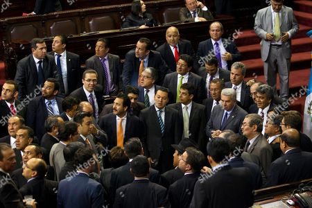 Lawmakers talk during the election of a new Vice President to replace Roxana Baldetti, who resigned on Friday, inside Congress in Guatemala City, . The discussion was suspended untill Wednesday. The Former Vice President Baldetti resigned Friday, May 8, and gave up her immunity from possible prosecution after her former private secretary, Juan Carlos Monzon Rojas, was accused of being the ringleader of a scheme to defraud the state of millions of dollars by taking bribes in exchange for lower customs duties