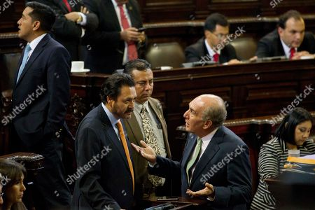 Mario Taracena, Gudy Taracena National Unity of Hope party lawmaker Mario Taracena, right, talks with ruling party lawmaker Gudy Rivera, left, during the second election day for a new Guatemalan Vice President, inside Congress in Guatemala City, . The Former Vice President Roxana Baldetti resigned Friday, May 8, and gave up her immunity from possible prosecution after her former private secretary Juan Carlos Monzon Rojas was accused of being the ringleader of a scheme to defraud the state of millions of dollars by taking bribes in exchange for lower customs duties