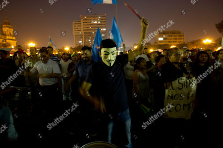 People protest against Guatemalan President Otto Perez Molina during a protest sparked by a recent corruption scandal, in Guatemala City, . Juan Carlos Monzon, the private secretary of Guatemala's vice president, has been identified by the authorities as the alleged ringleader of an organization dedicated to defrauding the state through corruption and theft