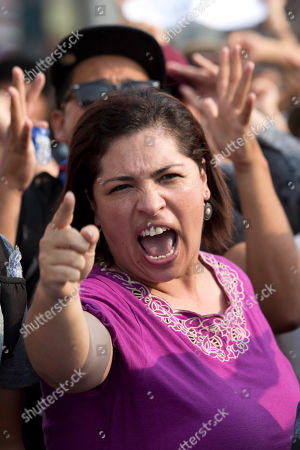 A woman chants slogans against Guatemalan President Otto Perez Molina during a protest sparked by a recent corruption scandal, in Guatemala City, . Juan Carlos Monzon, the private secretary of Guatemala's vice president, has been identified by the authorities as the alleged ringleader of an organization dedicated to defrauding the state through corruption and theft