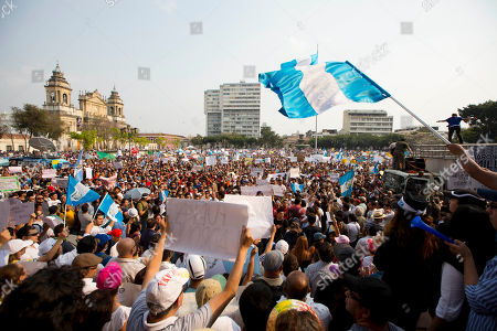 People take part in a protest against Guatemalan President Otto Perez Molina during a protest sparked by a recent corruption scandal, in Guatemala City, . Juan Carlos Monzon, the private secretary of Guatemala's vice president, has been identified by the authorities as the alleged ringleader of an organization dedicated to defrauding the state through corruption and theft