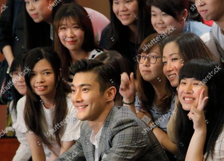 Choi Siwon Choi Siwon, center, a member of South Korean pop group Super Junior, smiles as he poses with his fans during a promotional event in Hong Kong