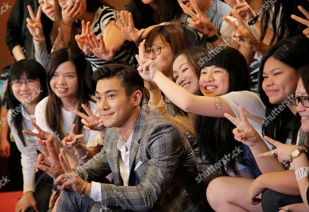 Choi Siwon Choi Siwon, center, a member of South Korean pop group Super Junior, poses with his fans during a promotional event in Hong Kong