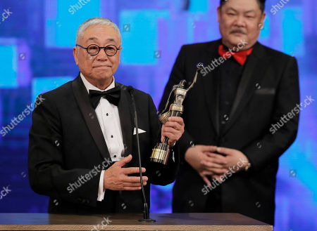 Stock Image of Kenneth Tsang Hong Kong actor Kenneth Tsang wins the Best Supporting Actor Award for his role in the movie 'Overheard 3' at the 34rd Hong Kong Film Awards in Hong Kong