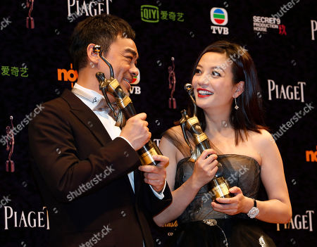 "Sean Lau, Zhou Wei Hong Kong actor Sean Lau, left, poses with his Best Actor award for the movie ""Overhead 3"" alongside Chinese actress Zhou Wei with her Best Actress award for the movie ""Dearest"" during the Hong Kong Film Awards in Hong Kong"