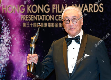 """Stock Picture of Kenneth Tsang Hong Kong actor Kenneth Tsang poses after winning the Best Supporting Actor award for his movie """"Overhead 3"""" during the Hong Kong Film Awards in Hong Kong"""