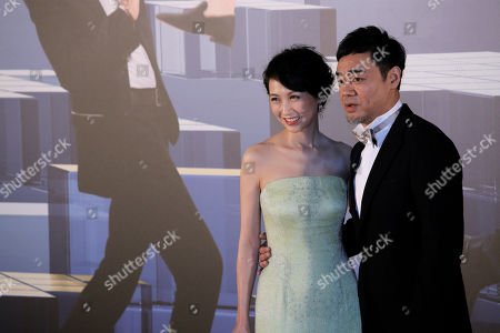Stock Image of Sean Lau, Amy Kwok Hong Kong actor Sean Lau, right poses with his wife Amy Kwok on the red carpet of the Hong Kong Film Awards in Hong Kong