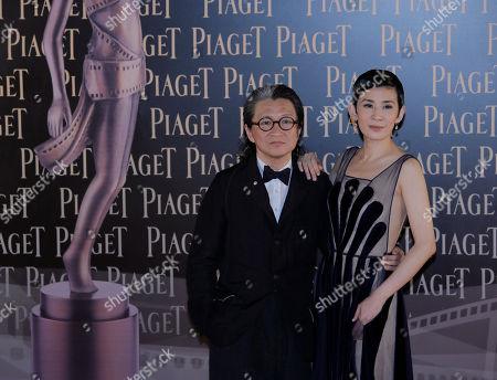 Sandra Ng, Peter Chan Hong Kong director Peter Chan poses with his wife actress Sandra Ng on the red carpet of the Hong Kong Film Awards in Hong Kong