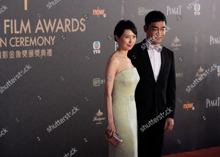 Stock Photo of Sean Lau, Amy Kwok Hong Kong actor Sean Lau poses with his wife Amy Kwok on the red carpet of the Hong Kong Film Awards in Hong Kong