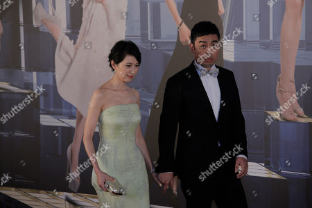 Sean Lau, Amy Kwok Hong Kong actor Sean Lau, right poses with his wife Amy Kwok on the red carpet of the Hong Kong Film Awards in Hong Kong