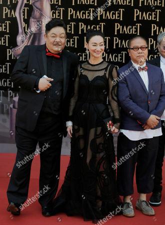 Fruit Chan, Kara Wai Ying Hung, Lam Suet From right, Hong Kong director Fruit Chan, actress Kara Wai Ying Hung and actor Lam Suet pose on the red carpet of the Hong Kong Film Awards in Hong Kong