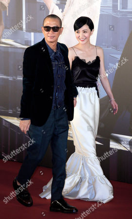 Stock Photo of Amber Kuo Hong Kong actor Nick Cheung, left, and Taiwan actress singer Amber Kuo arrive on the red carpet for the Hong Kong Film Awards in Hong Kong