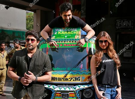 Arshad Warsi, Lauren Gottlieb, Jackky Bhagnani, Ashish R Mohan Bollywood actors Arshad Warsi, left, Lauren Gottlieb, right and Jackky Bhagnani top pose with film director Ashish R Mohan, center, inside an auto rickshaw after the trailer launch of their upcoming movie 'Welcome to Karachi' in Mumbai, India, . The film is set for release on May 21