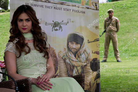 "Bollywood actor Lauren Gottlieb attends a promotional event for her upcoming film ""Welcome to Karachi,"" as a policeman stands guard in Srinagar, Indian controlled Kashmir, . The film is scheduled to be released on May 21. Gottlieb is a contemporary dancer and actor from Arizona, U.S"
