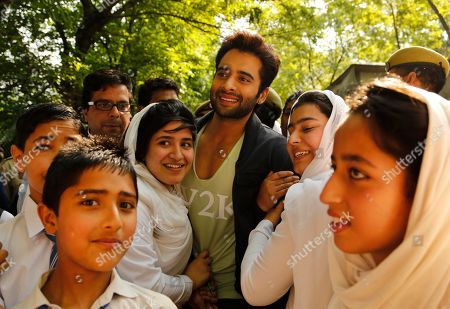 "Jackky Bhagnani Bollywood actor Jackky Bhagnani poses for photographs with Kashmiri students at a promotional event of his upcoming film ""Welcome to Karachi"" in Srinagar, Indian controlled Kashmir, . The film is scheduled to be released on May 21"