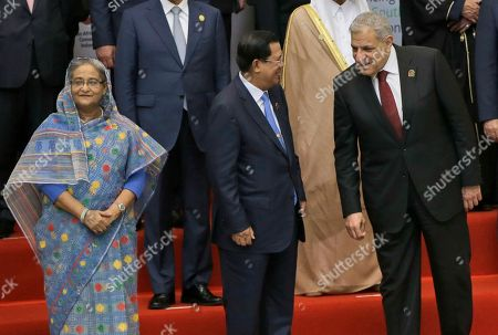 Sheikh Hasina, Hun Sen, Ibrahim Mahlab From left to right, Bangladeshi Prime Minster Sheikh Hasina, Cambodian Prime Minister Hun Sen and Egyptian Prime Minister Ibrahim Mahlab prepare for a group photo during the Asian African Summit in Jakarta, Indonesia