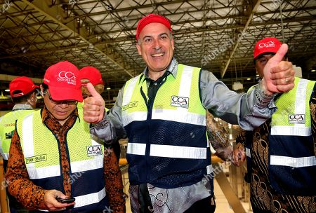 Muhtar Kent Coca-Cola CEO Muhtar Kent smiles and gives thumbs up to photographers during an inauguration ceremony of two new production lines at a bottling plant in Cibitung, West Java, Indonesia Tuesday, March, 31, 2015. The world's biggest beverage company says in its press release the inauguratio represents several major investments being made in Indonesia as part of the Coca-Cola system's plan to invest US $500 million to accelerate growth in the Indonesian market