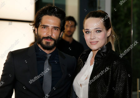 Actress Laura Chiatti and her husband actor Marco Bocci attend a Giorgio Armani exclusive fashion show in Milan, Italy, . The Milan Expo 2015 world's fair has some heady ambitions: devise a plan to feed the planet, boost Italy's economy and raise Milan's profile. Giorgio Armani has invited VIP guests to an exclusive fashion show on the eve of Expo and opens a museum recounting his 40-year history called Silos, which will remain a fixture