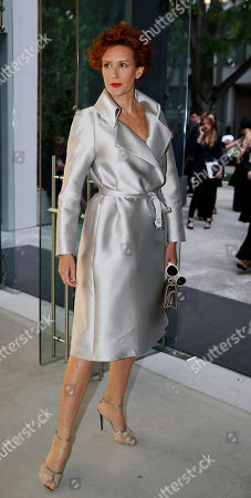 Actress Lucrezia Lante Della Rovere attends a Giorgio Armani exclusive fashion show in Milan, Italy, . The Milan Expo 2015 world's fair has some heady ambitions: devise a plan to feed the planet, boost Italy's economy and raise Milan's profile. Giorgio Armani has invited VIP guests to an exclusive fashion show on the eve of Expo and opens a museum recounting his 40-year history called Silos, which will remain a fixture