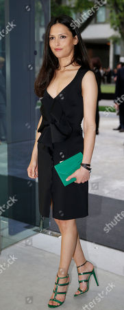 Stock Photo of Nathalie Dompe' attends a Giorgio Armani exclusive fashion show in Milan, Italy, . The Milan Expo 2015 world's fair has some heady ambitions: devise a plan to feed the planet, boost Italy's economy and raise Milan's profile. Giorgio Armani has invited VIP guests to an exclusive fashion show on the eve of Expo and opens a museum recounting his 40-year history called Silos, which will remain a fixture