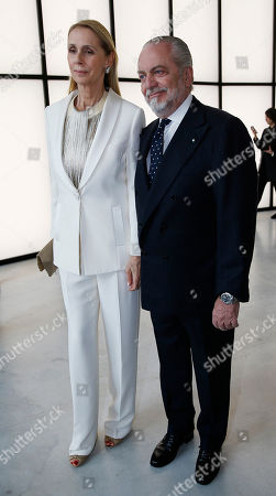 Aurelio De Laurentis and his wife Jacqueline Baudit attend a Giorgio Armani exclusive fashion show in Milan, Italy, . The Milan Expo 2015 world's fair has some heady ambitions: devise a plan to feed the planet, boost Italy's economy and raise Milan's profile. Giorgio Armani has invited VIP guests to an exclusive fashion show on the eve of Expo and opens a museum recounting his 40-year history called Silos, which will remain a fixture