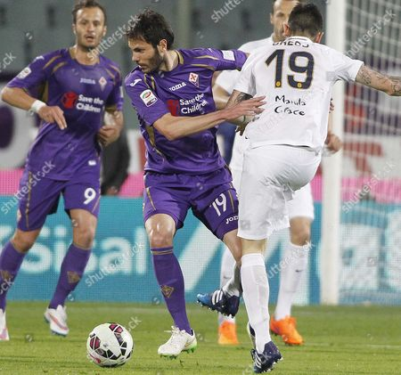 Fiorentina's José María Basanta, left, vies for the ball with Verona's Leandro Greco during a Serie A soccer match between Fiorentina and Verona at the Artemio Franchi stadium in Florence, Italy