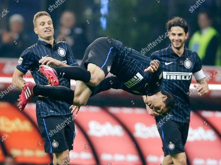 Anderson Hernanes, Andrea Ranocchia, Nemanja Vidic Inter Milan's Anderson Hernanes, center, celebrates with his teammates Andrea Ranocchia, right, and Nemanja Vidic after scoring during the Serie A soccer match between Inter Milan and Roma at the San Siro stadium in Milan, Italy