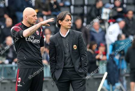 Filippo Inzaghi, Christian Abbiati Milan goalkeeper Christian Abbiati, left, and Milan coach Filippo Inzaghi share a word prior to the start of a Serie A soccer match between Udinese and Milan at the Friuli Stadium in Udine, Italy
