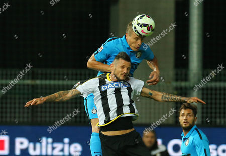 Nemanja Vidic, Cyril Thereau Inter Milan's Nemanja Vidic, top, jumps for the ball with Udinese's Cyril Thereau during the Serie A soccer match between Udinese and Inter Milan at the Friuli stadium in Udine, Italy