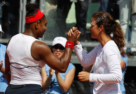 Serena Williams, Mary Joe Fernandez Serena Williams, left, shakes hand with Mary Joe Fernandez, the United States captain after winning a Fed Cup World Group playoff tennis match against Italy's Camila Giorgi in Brindisi, Italy, . Top-ranked Serena Williams overcame a stiff challenge in the opening set for a 7-6 (5), 6-2 win over Camila Giorgi on Saturday to give the United States a 1-0 lead over Italy in a Fed Cup World Group playoff