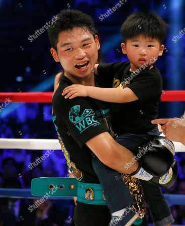 Takashi Miura Japanese champion Takashi Miura holds his son Takeharu after knocking out Australian challenger Billy Dib in the third round to defend his WBC super featherweight boxing title in Tokyo