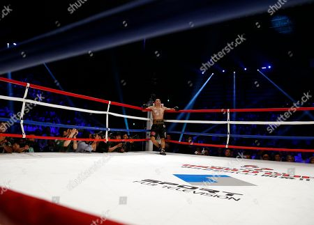 Stock Photo of Takashi Miura Japanese champion Takashi Miura waits at a corner for the referee count after knocking down Australian challenger Billy Dib in the third round in their WBC super featherweight boxing title match in Tokyo, . Miura defended his title by knockout in the round