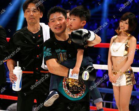 Stock Image of Takashi Miura, Takeharu Miura Japanese champion Takashi Miura holds his son, Takeharu, after knocking out Australian challenger Billy Dib in the third round to defend his WBC super featherweight boxing title in Tokyo