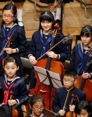 Princess Aiko Japanese Princess Aiko, center, smiles after they play the cello during a concert by Gakushuin University's alumni in Tokyo