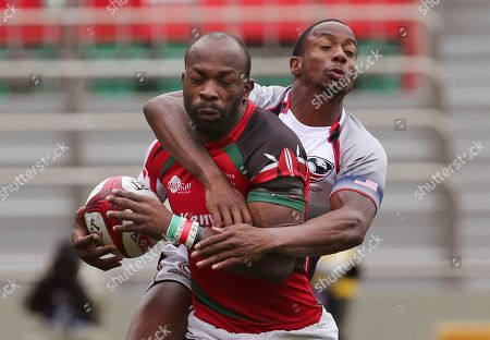 Lavin Asego,Carlin Isles Lavin Asego of Kenya is tackled by Carlin Isles of the United State during their qualifying match of Tokyo Sevens rugby tournament in Tokyo, . Kenya won the match 27-5