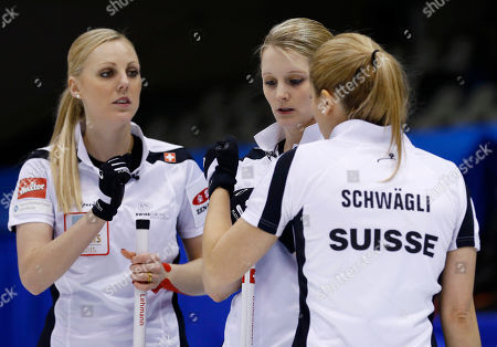 Nadine Lehmann, Nicole Schwaegli, Marisa Winkelhausen Switzerland's Nadine Lehmann, left, Nicole Schwaegli, center, and Marisa Winkelhausen react in the seventh end during their final match against Canada at the World Women's Curling Championship in Sapporo, northern Japan