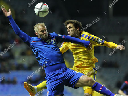Eidur Gudjohnsen, Yuri Logvinenko Iceland's Eidur Gudjohnsen, left, and Kazakhstan's Yuri Logvinenko jump for a ball during the Euro 2016 qualifying soccer match between Kazakhstan and Iceland at Astana Arena stadium in Astana, the capital of Kazakhstan