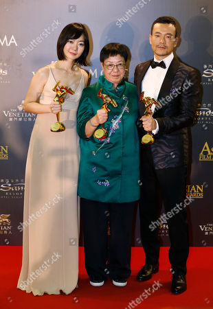 Bae Doo-na, Ann Hui, Liao Fan From left, South Korean actress Bae Doo-na, Hong Kong director Ann Hui and Chinese actor Liao Fan pose after winning the Best Actress, the Best Director and the Best Actor of the Asian Film Awards in Macau