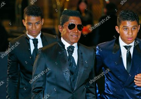 Jermaine Jackson, Jaafar Jackson, Jermajesty Jackson U.S. singer Jermaine Jackson, center, and his two sons, Jaafar, left, and Jermajesty, walk on the red carpet upon their arrival for the Asian Film Awards in Macau