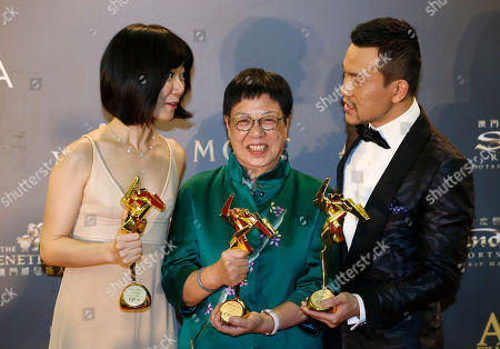 Stock Picture of Bae Doo-na, Ann Hui, Liao Fan From left, South Korean actress Bae Doo-na, Hong Kong director Ann Hui and Chinese actor Liao Fan pose after winning the Best Actress, the Best Director and the Best Actor of the Asian Film Awards in Macau