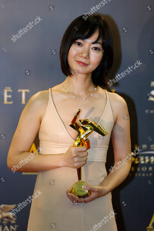 "Stock Photo of Bae Doo-na South Korean actress Bae Doo-na poses after winning the Best Actress of her movie ""A Girl At My Door"" of the Asian Film Awards in Macau"