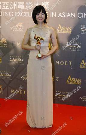 "Stock Image of Bae Doo-na South Korean actress Bae Doo-na poses after winning the Best Actress of her movie ""A Girl At My Door"" of the Asian Film Awards in Macau"