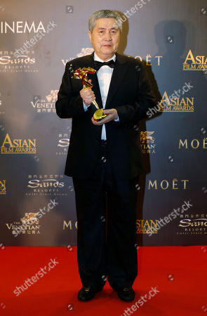 Stock Picture of Im Kwon-taek South Korean director Im Kwon-taek poses after winning the Lifetime Achievement Award of the Asian Film Awards in Macau