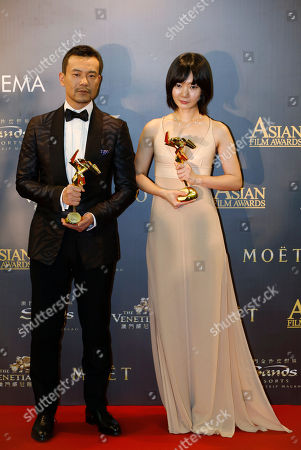 "Bae Doo-na, Liao Fan South Korean actress Bae Doo-na, right, and Chinese actor Liao Fan pose after winning the Best Actress award for the film ""A Girl At My Door"" and the Best Actor for the film ""Black Coal, Thin Ice"" of the Asian Film Awards in Macau"