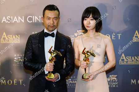 "Bae Doo-na, Liao Fan South Korean actress Bae Doo-na, right, and Chinese actor Liao Fan pose after winning the Best Actress of her movie ""A Girl At My Door"" and the Best Actor of his movie ""Black Coal, Thin Ice"" of the Asian Film Awards in Macau"