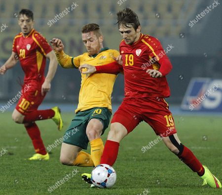 Oliver Bozanic, Besart Abdurahimi Australia's Oliver Bozanic, center, vies for the ball with Macedonia's Besart Abdurahimi, right, during their international friendly soccer match, at the Philip II Arena, in Skopje, Macedonia